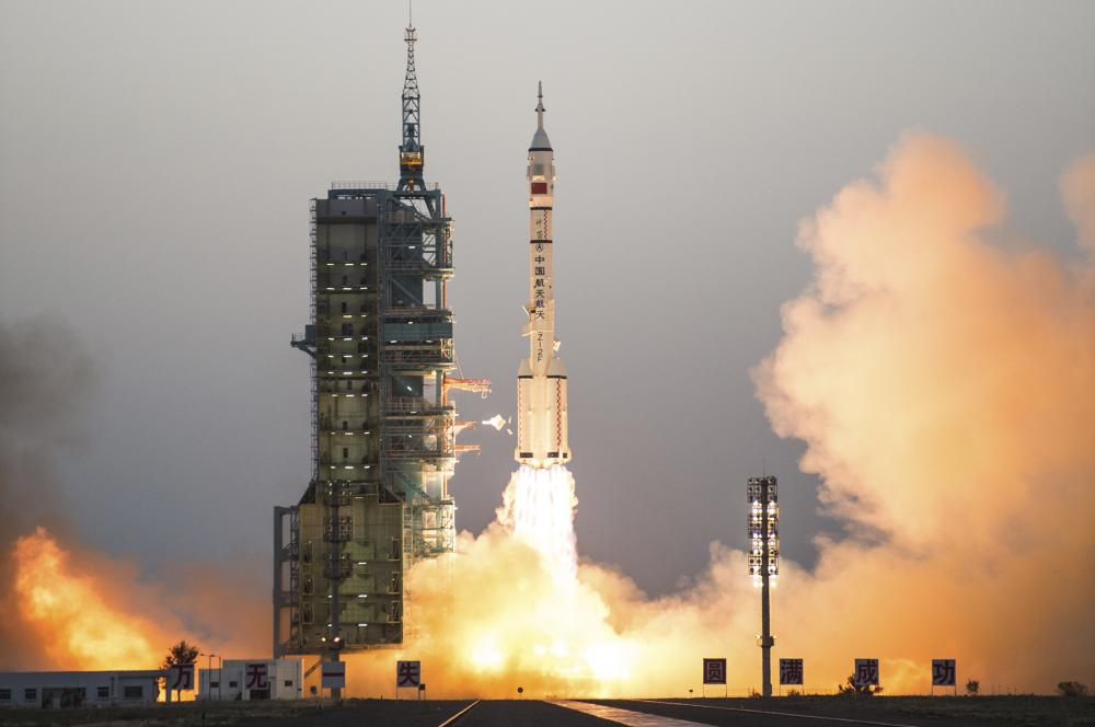 China blasts off two astronauts on longest manned mission
